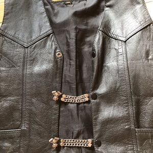 Vest snap closure. Wear on motorcycle vest